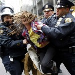 """An Occupy Wall Street demonstrator is arrested by New York City Police during what protest organizers called a """"Day of Action"""" in New York"""
